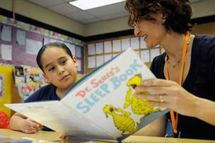 Reading Partners volunteer Julie Osborn tutors fourth-grader Sara Luis.