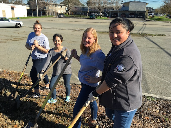 Four AmeriCorps members participating in a day of service