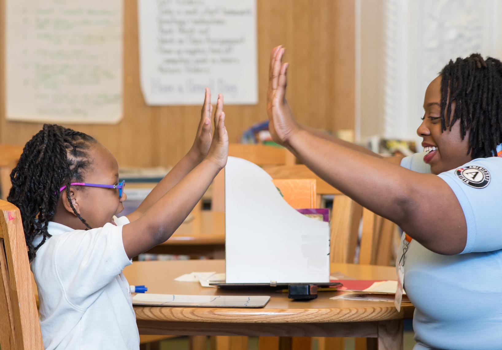 Celebrating progress with a student