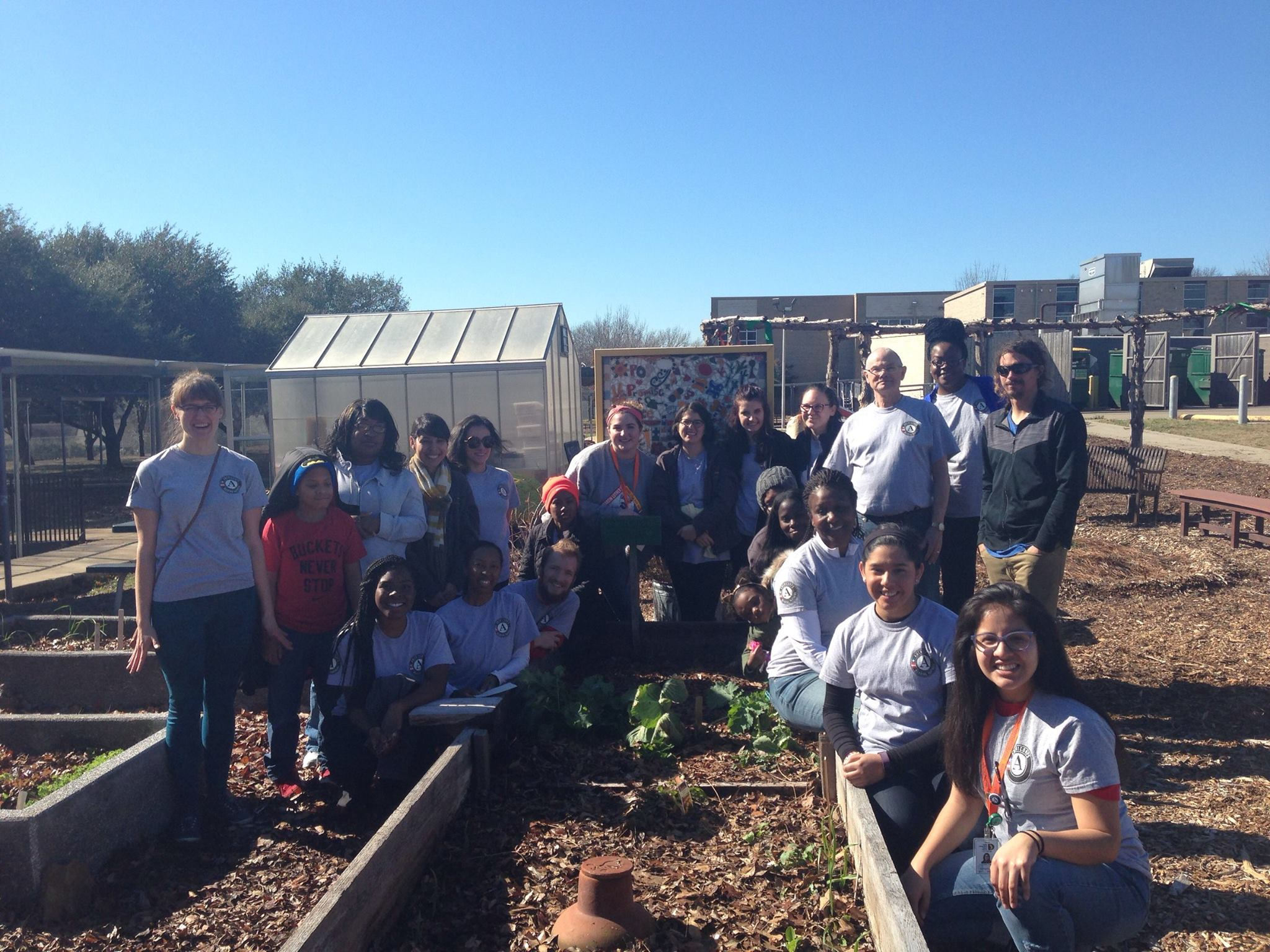 North Texas team working in a community garden